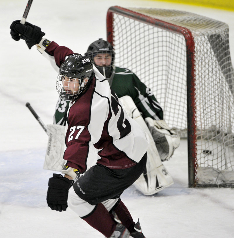 Jared Wood celebrates his second-period goal Monday night that gave Gorham a 3-2 lead. The Rams tacked on two third-period goals to post a 5-2 win over previously unbeaten Bonny Eagle.