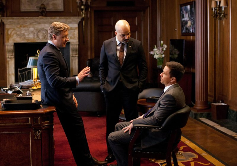 "Russell Crowe, left, Jeffrey Wright and Mark Wahlberg in ""Broken City."""