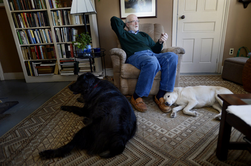 Wesley McNair at home in Mercer with his dogs Gus, left, and Rosie.