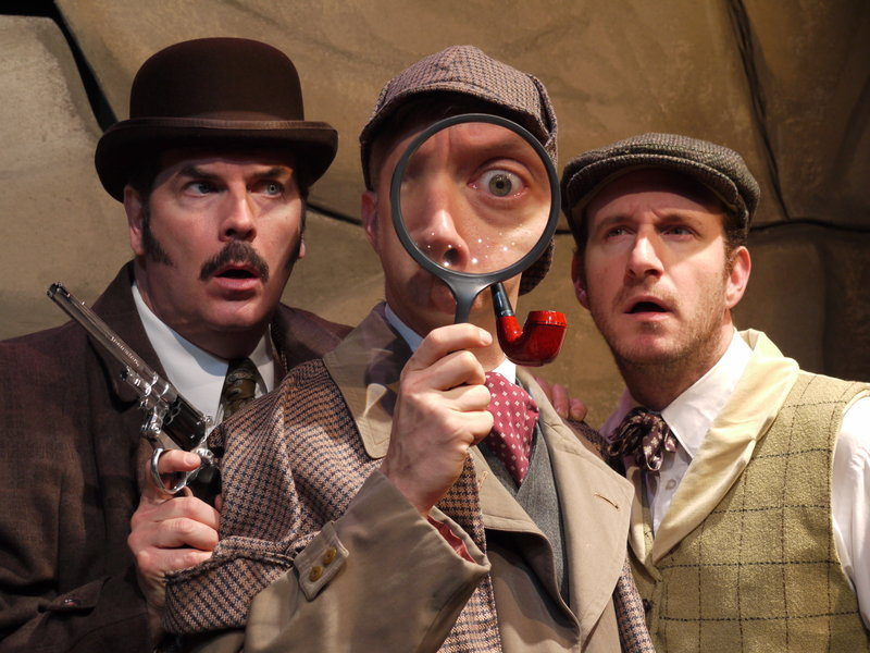 "Looking for a clue in The Public Theatre's ""The Hound of the Baskervilles"" are J.T. O'Connor as Watson, Michael Frederic as Holmes and Dan Matisa as Sir Henry Baskerville."