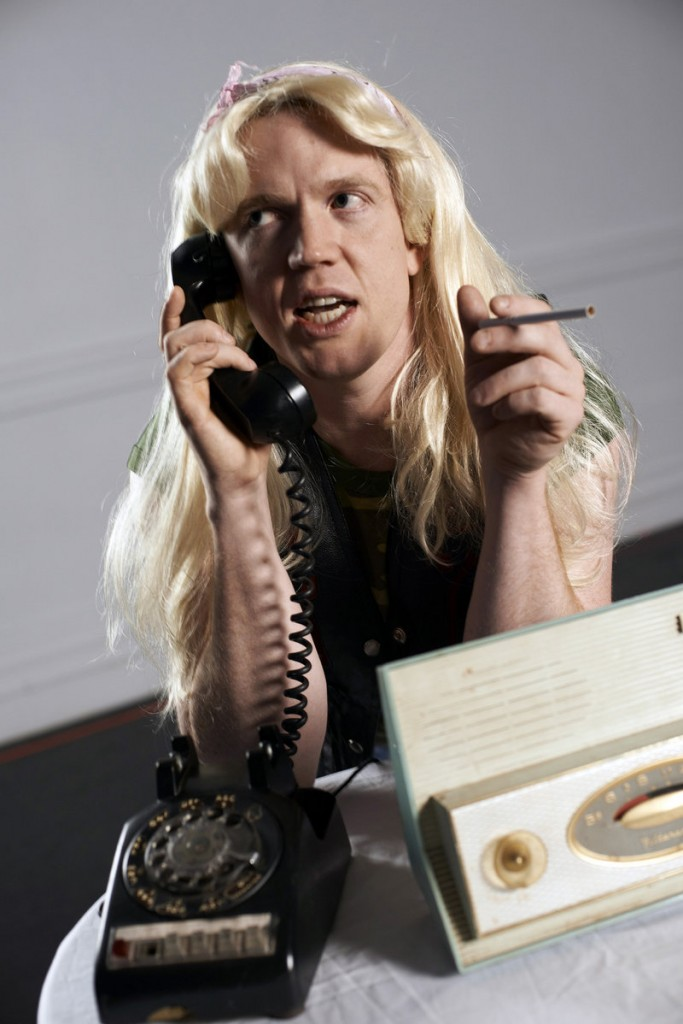 "Dustin Tucker as caller Didi Snavely, who wants to know if anything can ""be done about those Halloween pranksters."""