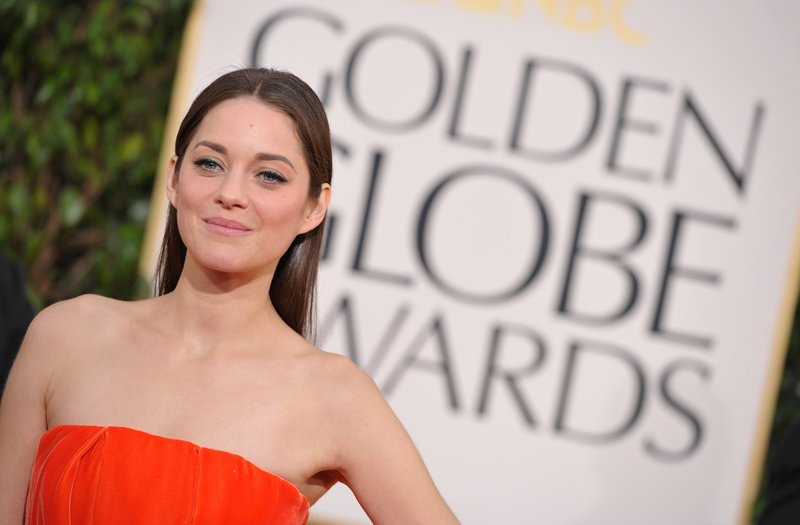 Actress Marion Cotillard arrives at the 70th annual Golden Globe Awards at the Beverly Hilton Hotel on Sunday in Beverly Hills, Calif.