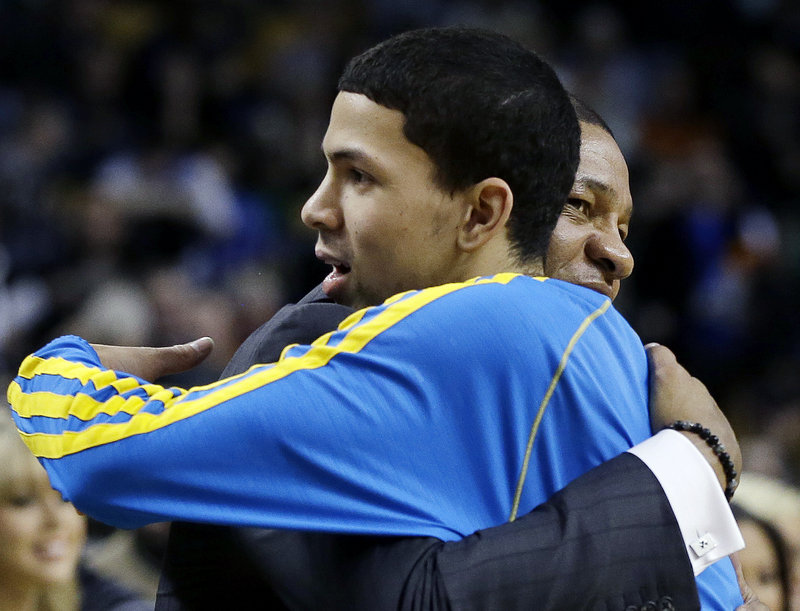 Austin Rivers of the Hornets hugs his father, Celtics Coach Doc Rivers, after scoring eight points to help New Orleans end Boston's six-game winning streak with a 90-78 victory.