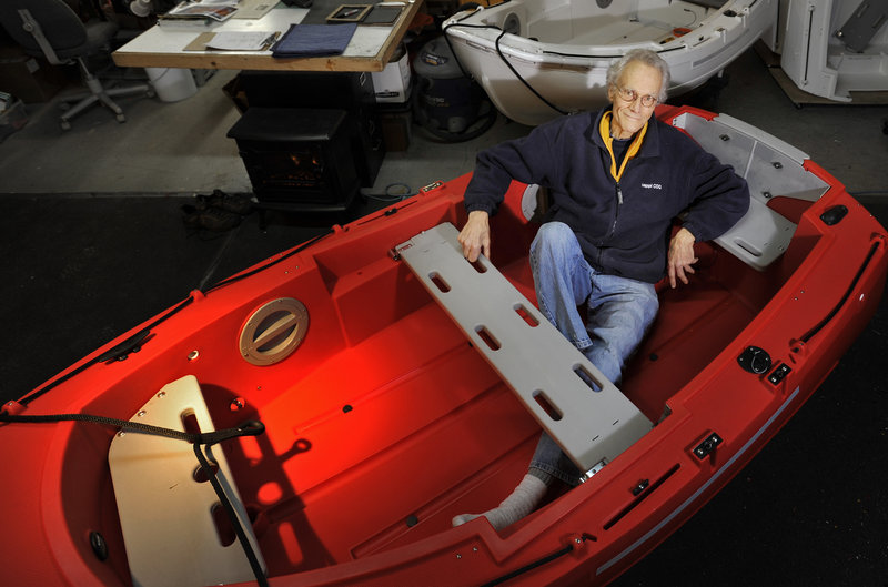 "David Hulbert, designer of the Pudgy, in one of the dinghies he calls the world's only unsinkable lifeboat that can be sailed, unlike a rubber raft that would ""drift aimlessly."""