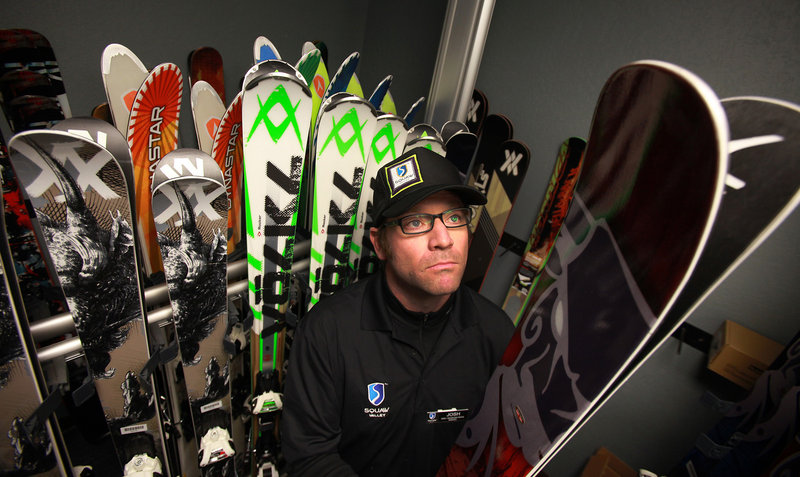 Squaw Valley ski demo shop manager Josh Holm pulls a pair of wide skis off a rack at the shop in Truckee, Calif. In the same four-year period, sales of skis climbed 3 percent, while sales of snowboards and snowboard equipment slipped 21 percent.