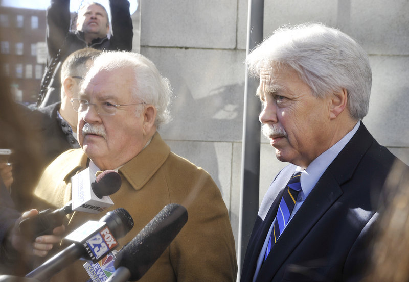 Defense attorney Dan Lilley (left) and his client, Mark Strong Sr., speak to the media outside of Cumberland County Court following a hearing Friday, Jan. 18, 2013.