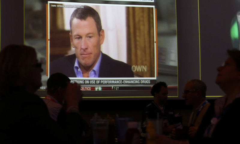 A video screen at a hotel restaurant in Grapevine, Texas, on Friday shows a replay telecast of a segment of Lance Armstrong being interviewed by Oprah Winfrey.