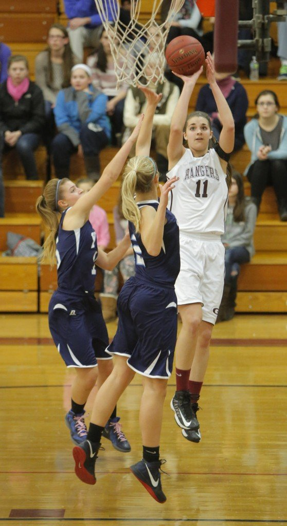 Ashley Storey of Greely shoots over York's Anne Graziano, left, and Emily Campbell. Storey scored 14 points, but Campbell had 16 points and 11 rebounds to help lead the Wildcats to a 62-39 victory.