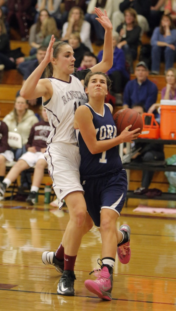Ruby Cribby of York drives to the basket and draws a foul against Greely's Ashley Storey. Cribby finished with 10 points.