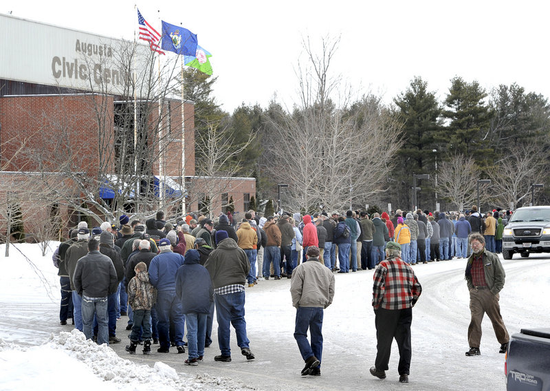 Gun enthusiasts line up for the 9 a.m. opening of a gun show at the Augusta Civic Center on Saturday, the first in Maine since the Newtown, Conn., shooting deaths Dec. 14 generated debate on tighter controls.