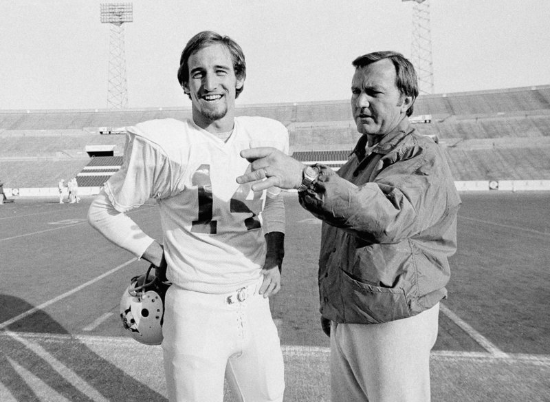 PATRIOTS PAST: Quarterback Steve Grogan, left, gets a pointer from Coach Chuck Fairbanks at Schaefer Stadium in Foxborough, Mass., in December 1976.