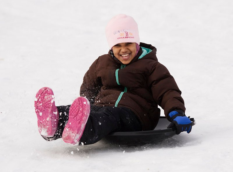 Sara Dhalai, 8, of Portland finds out sliding downhill isn't so scary