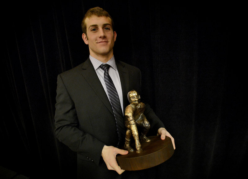 Donald Goodrich poses with the Fitzpatrick Trophy after receiving the award given to Maine's top senior football player.