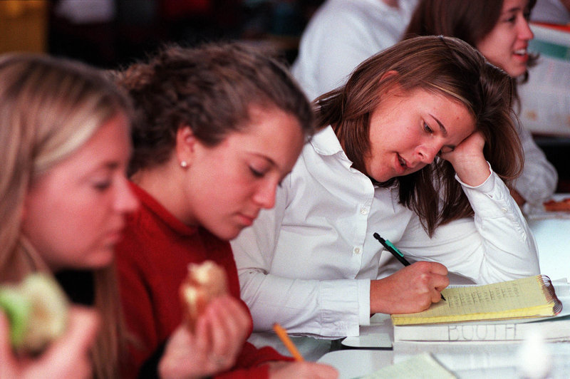 "A Catherine McAuley High School student prepares for a test during lunch period in a 2000 file photo. A McAuley teacher questions a letter that he said ""baselessly denigrates"" the Portland school."