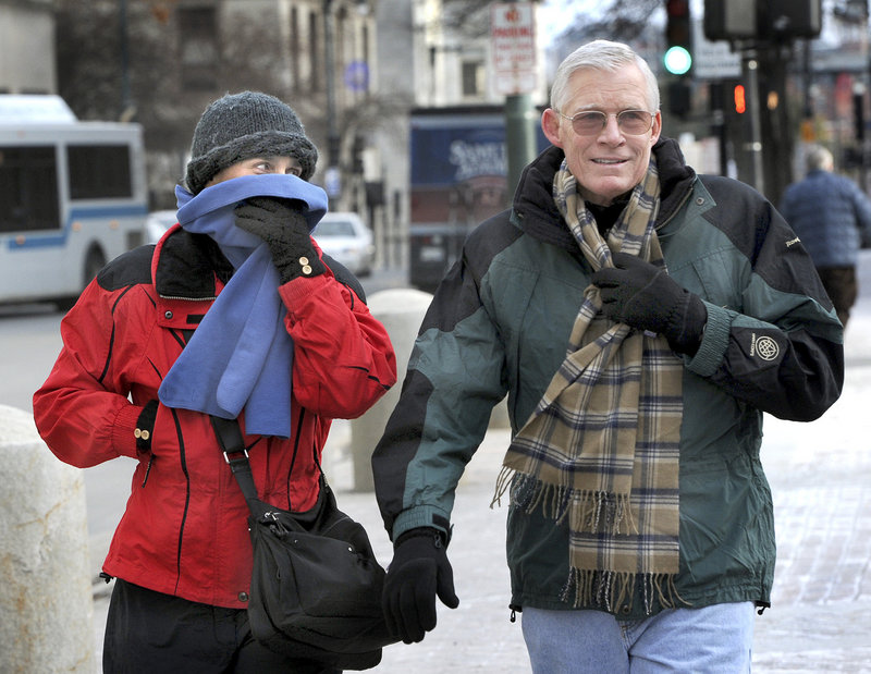 Portland visitors Jodie and Arthur Roeca from Honolulu, Hawaii head to Reny's on Congress Street to buy a hat and other warm clothes as they and many others brave frigid temperatures on Tuesday, Jan. 22, 2013.