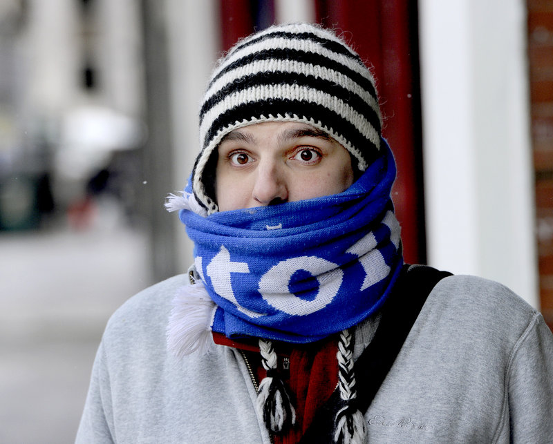 Falmouth resident Zack Parr waits for a bus along Congress Street in Portland as he and many other Mainers brave frigid temperatures on Tuesday, Jan. 22, 2013.