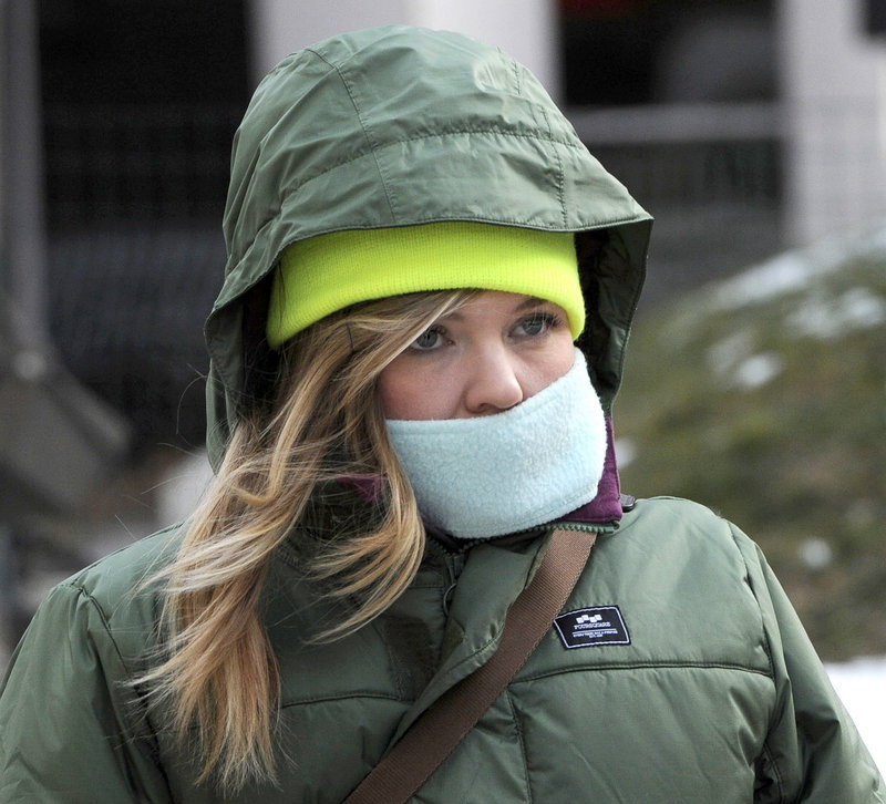 Kristin O'Brien from Portland was one of many pedestrians who braved the cold and wind Tuesday, Jan. 22, 2013.