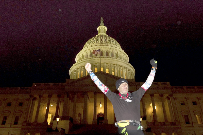 Exhausted from his run, 56-year-old Gary Allen from Great Cranberry Island, Maine, celebrates after finally reaching the U.S. Capitol on Monday night, Jan. 21, 2012. Allen averaged 50 miles a day as he ran 700 miles from Maine to Washington, DC, in two weeks for charity.
