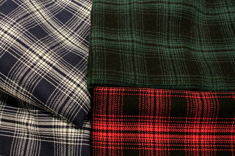 Maine Woolens of Brunswick makes these Oakley plaid blankets. Maine Woolens' products are cotton or wool, and are piece-dyed in Brunswick.