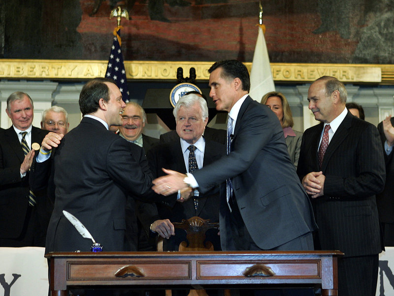 Then-Gov. Mitt Romney, right, in 2006 celebrates after signing into law a bill designed to guarantee all state residents have health insurance. Other states are looking to the Bay State for guidance as they prepare to develop their own systems.