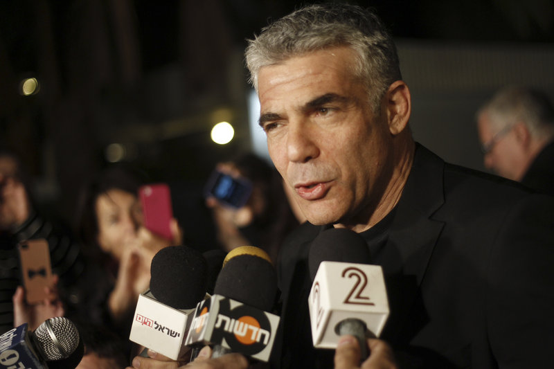 Yair Lapid, leader of a party that won 19 seats in Israel's parliament Tuesday, speaks to reporters in Tel Aviv Wednesday.