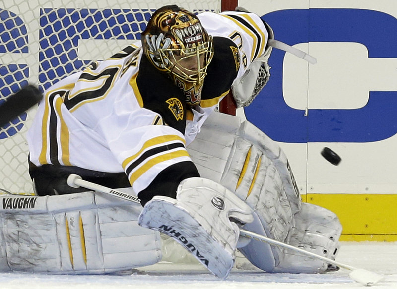 Tuukka Rask of the Bruins makes a stick stop in the first period Wednesday night in New York. The Rangers beat Rask and the Bruins 4-3 in overtime.