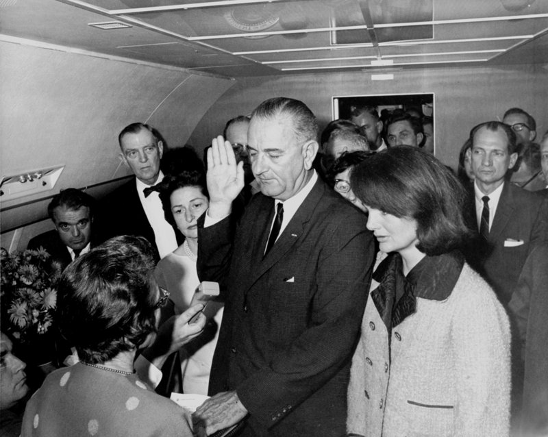 The only woman to swear in a president of the United States was Judge Sarah T. Hughes. Seen here but with her back to the camera, Hughes administered the oath of office to Lyndon Johnson on Air Force One following the assassination of John F. Kennedy. Jacqueline Kennedy looks on at right.