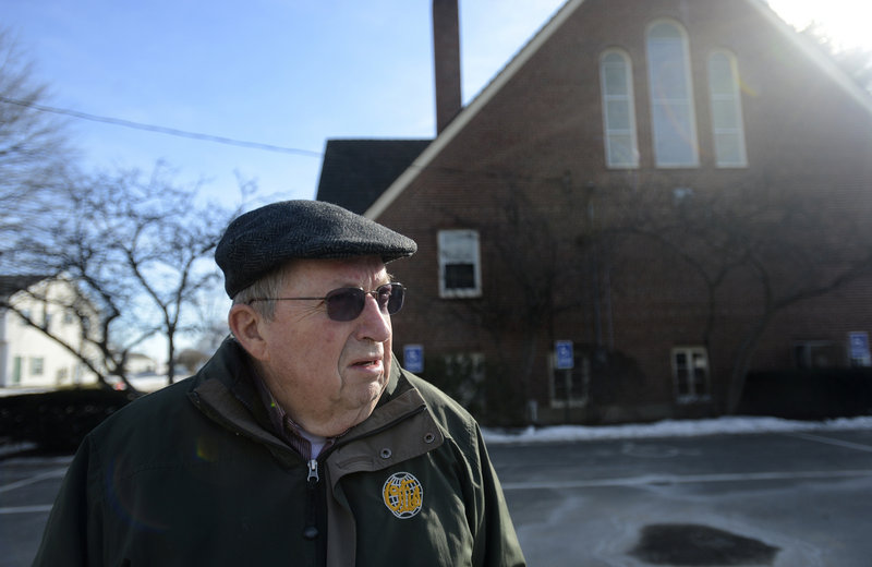Parishioner John Labrie of South Portland discusses the potential closure of St. John the Evangelist Church in South Portland Thursday, January 24, 2013. The church has been recommended for closure by the finance commission for the Catholic parish in South Portland.