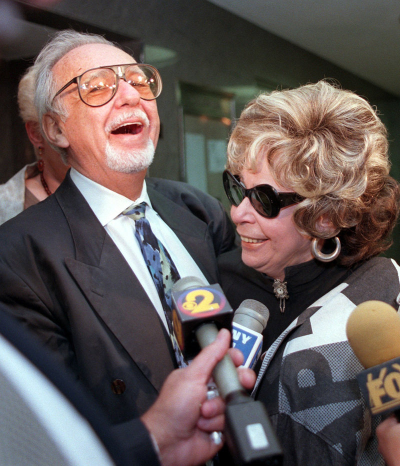 Burton Pugach laughs with his wife, Linda, outside Queens Criminal Court in New York in 1997, where he was on trial for threatening another, younger woman after she left him.