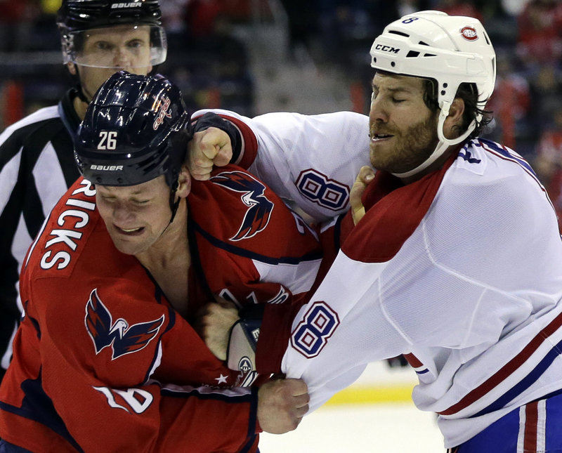Washington Capitals center Matt Hendricks turns from a roundhouse right by Montreal Canadiens winger Brandon Prust during Thursday's game, won by Montreal.