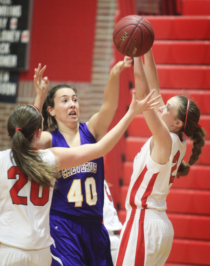 Jessica Willerson of Cheverus defends against South Portland's Holly Black, right, and Meaghan Doyle.