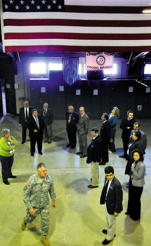 Army National Guard Lt. Col. Dwaine Drummond leads members of the Legislature's Veterans and Legal Affairs Committee on a tour of the Gardiner Armory on Jan. 23.