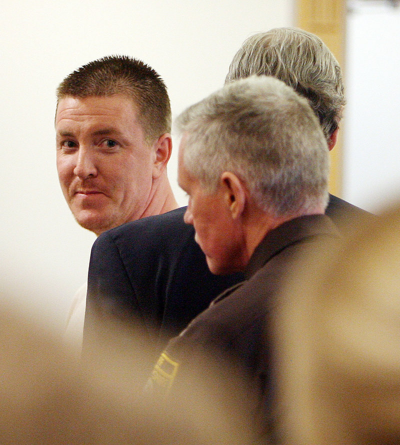 In this Friday March 26, 2010 file photo Jesse Brooks, 33, looks back at family and friends after being sentenced in Rockingham County Superior Court in Brentwood, N.H. Brooks was convicted of helping his millionaire father recruit friends to kill handyman Jack Reid in 2005 and was sentenced to 15 to 30 years in prison. Monday Dec. 28, 2013, Brooks' mother, Lorraine Brooks, announced at a press conference she has hired a team of private investigators, who say new evidence suggest her son is innocent. (AP Photo/Jim Cole)