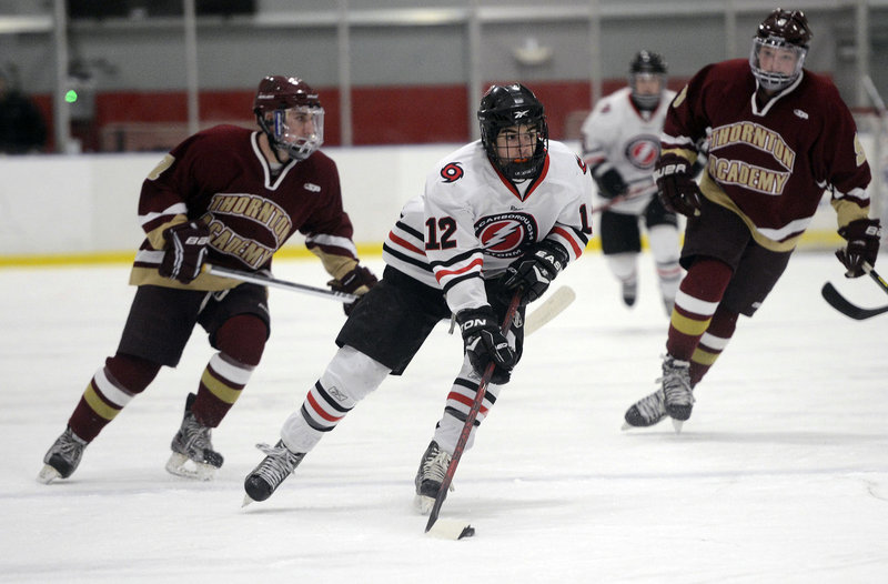 Scarborough's Garrett McDonald controls the puck as he heads down the ice during the Red Storm's 4-3 win over Thornton Academy on Monday.