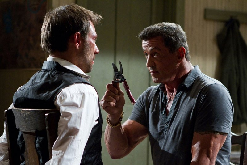 "Christian Slater, left, and Sylvester Stallone square off in ""Bullet to the Head."""