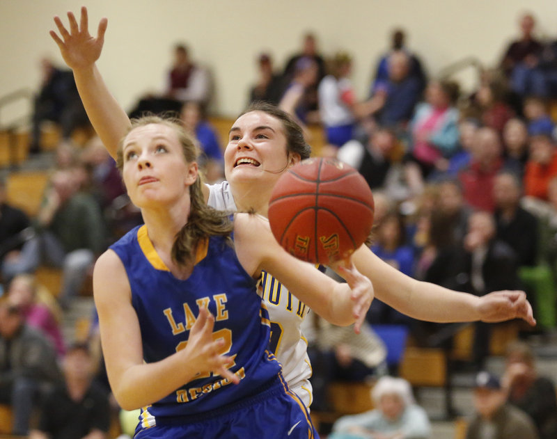 Miranda Chadbourne of Lake Region looks for a shot after beating Falmouth's Molly Ryan off the dribble in Tuesday night's Western Maine Conference girls' basketball game at Falmouth. Lake Region won, 54-31.