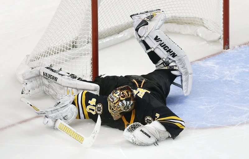 Tuukka Rask of the Bruins sprawls to make a save on David Clarkson of New Jersey during the shootout phase of Boston's 2-1 victory Tuesday night.