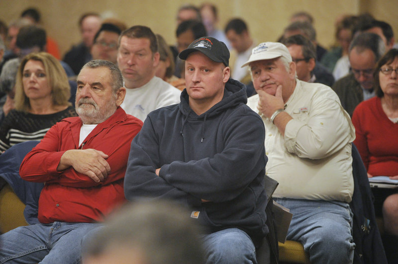 Fishermen listen to scientists and regulators during the New England Fishery Management Council meeting in Portsmouth, N.H. Many fishermen oppose lower catch limits, but advocates argue they are critical to preserving the future of fish stocks.