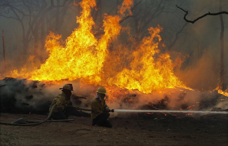 Extreme weather has become less unusual in many parts of the country – including Texas, where dry conditions helped to fuel this 2011 wildfire blaze near Smithville.