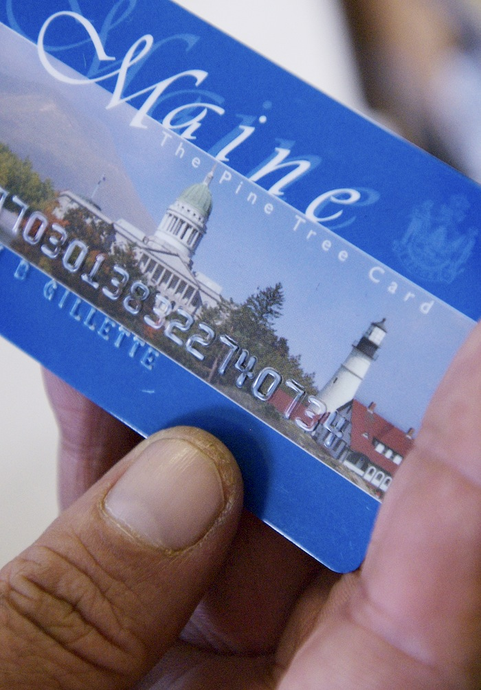 In this August 2008 file photo, Keven Gillette of Portland uses a magnetic food-stamp card to buy his groceries. Federal officials have denied a request by the LePage administration to require Mainers who use food-stamps benefits cards to show photo ID when they buy groceries.