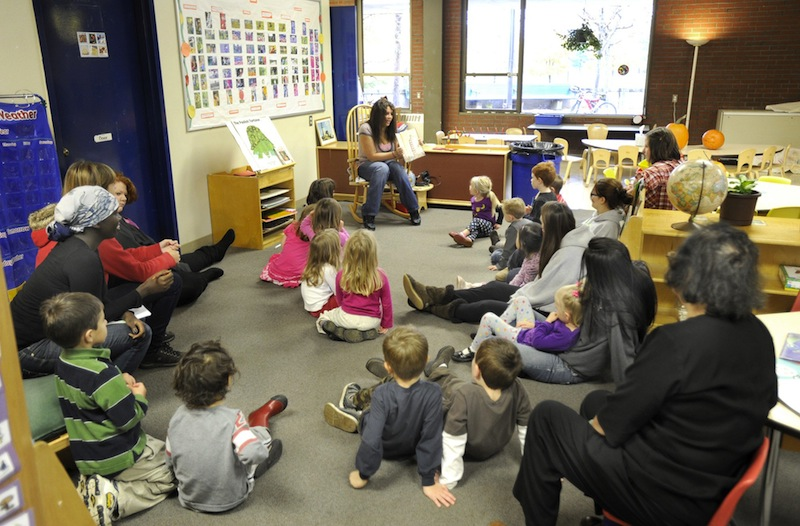 In this October 2010 file photo, Aaliyah Mills reads to preschoolers at Portland Arts and Technology School in Portland. President Obama's proposal to provide quality early-childhood education to all children, including preschool for all 4-year-olds, would mean a significant expansion of those programs in Maine, where only about 60 percent of public school districts now offer pre-kindergarten classes.