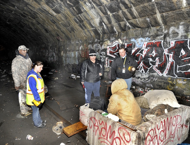 Maine HUD field director Bill Burney, Angela Havlin, Alicia Martinez and Josh O'Brien all with the Oxford Street Shelter interview a homeless man (in the tunnel) under the Casco Bay Bridge as the city of Portland conducted its annual homeless point in time survey on Wednesday, Jan. 30, 2013. City officials said Tuesday, Feb. 26, 2013 they are moving forward with proposals to reduce homelessness, including a call for proposals to build transitional housing in Portland.