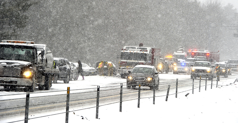 Southbound I-295 between Yarmouth and Falmouth slowed to a crawl Friday morning after a 19-vehicle accident that sent some vehicles off the road and into a deep gully. Several people were sent to the hospital with minor injuries.