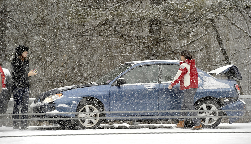 Drivers who were involved in the pileup on I-295 southbound await tow trucks on Friday.
