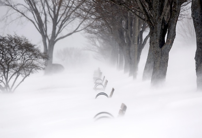 Snow blows and drifts over the benches along the Eastern Promenade during the blizzard on Munjoy Hill in Portland Saturday morning.