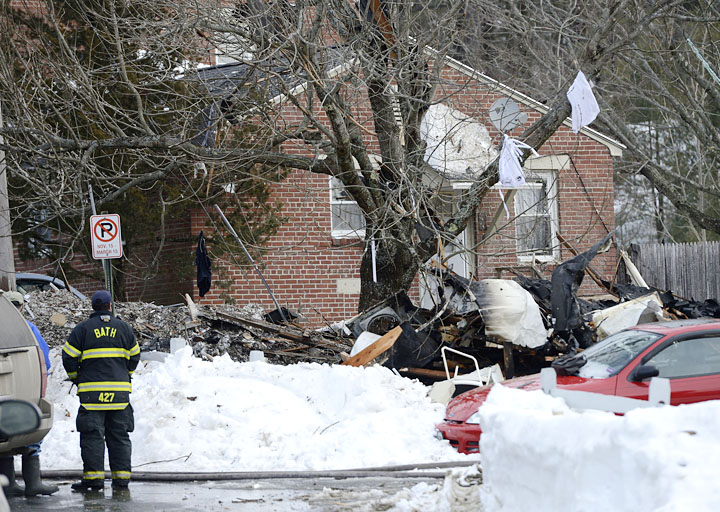 Firefighters on the scene of the explosion in Bath on Tuesday. Authorities say debris from the explosion landed as far as a quarter-mile away.
