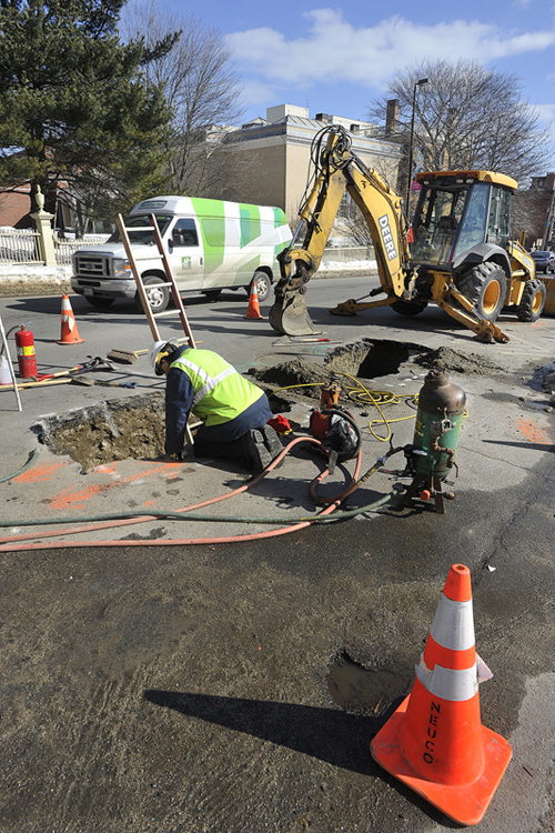 John Ewing/staff photographer: Workers from Unitil repair two natural gas line leaks on High Street in Portland on Thursday, February 14, 2013.