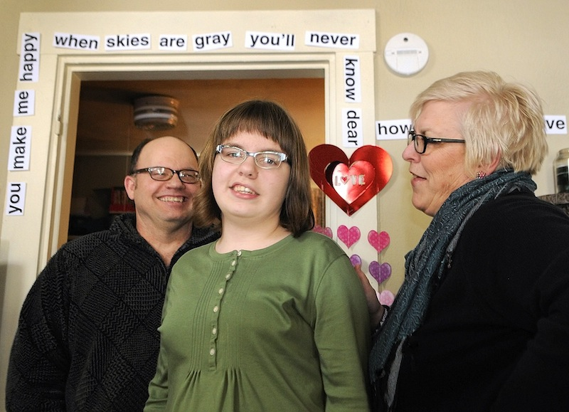The Bowden family, Kevin, left, Addie, center, and Heidi stand in their Augusta home underneath Valentine's Day decorations Heidi made for her daughter Addie. Photographed Friday, Feb. 15, 2013.