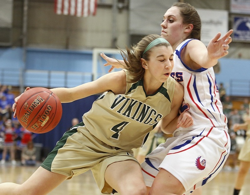 Mallory Nelson of Mt. Ararat stands her ground as Anna Winslow of Oxford Hills attempts to drive along the baseline during their quarterfinal at the Augusta Civic Center. Mt. Ararat and Bangor will meet Wednesday in one of the regional semifinals.