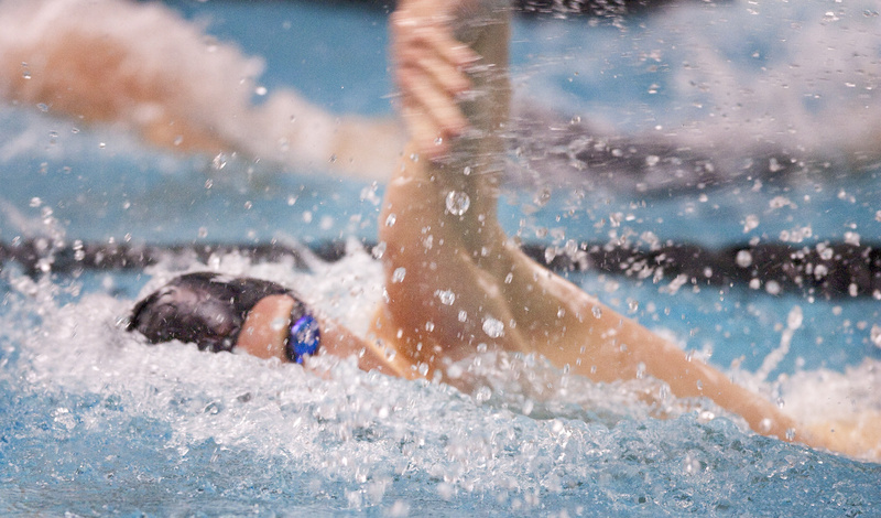 Nick Sundquist, a senior at Windham, powers his way to a win in the 200-yard freestyle event in the Class A state swimming championships Monday at Bowdoin College.